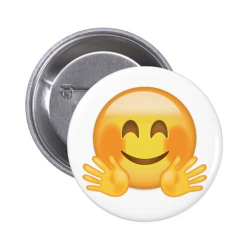 Hugging face emoji pinback button